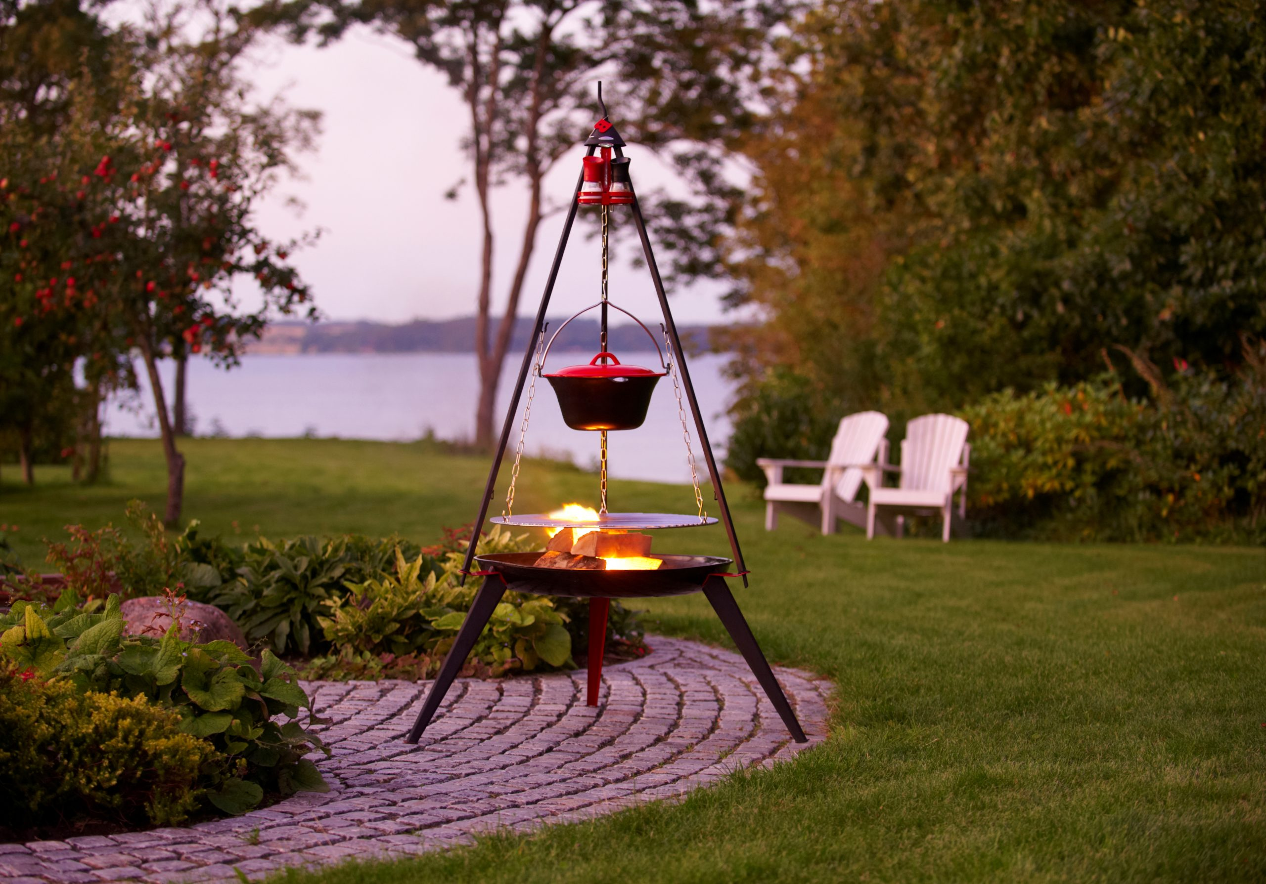 Garden atmosphere - Bon-fire Tripod with Stew pot, Grill grid and Spice rack w. 2 spice mills. Attached to Bon-fire Brazier with long legs.